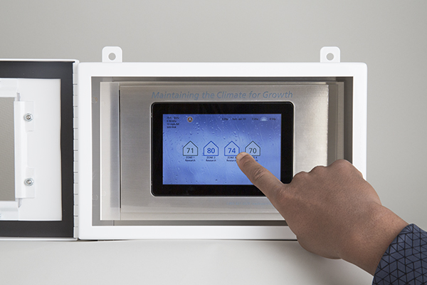 Seed cabinet open with hand small web
