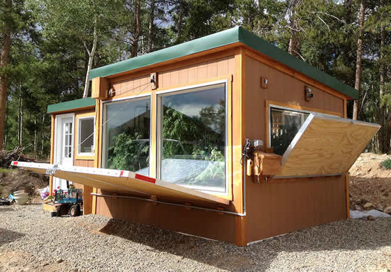 Net Zero Energy Greenhouse with solar panels and insulating shutters, Leadville Colorado