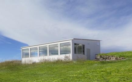 solar greenhouse on hillside