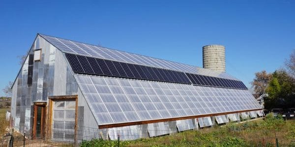Off-grid commercial greenhouse with solar panels