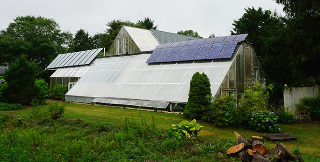 The year-round greenhouse at The Green Center is outfitted with a solar PV system and a solar hot water system
