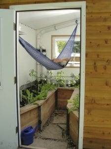 Custom greenhouse oasis with hammock