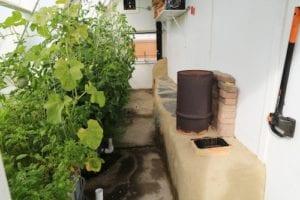 Rocket mass heater in a greenhouse