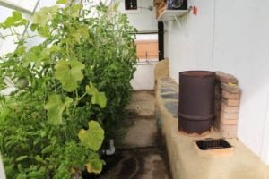 Greenhouse rocket mass heater at Verge permaculture