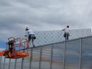 installing glazing material on a greenhouse