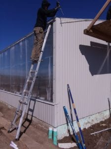 worker on greenhouse
