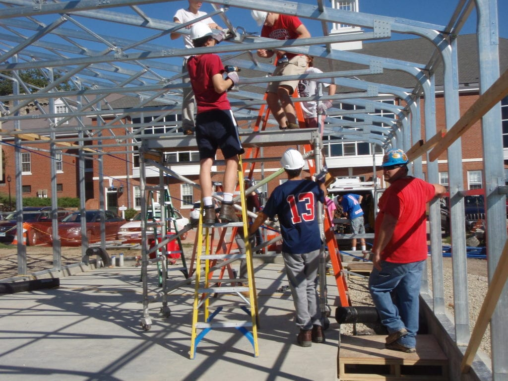 Students building greenhouse