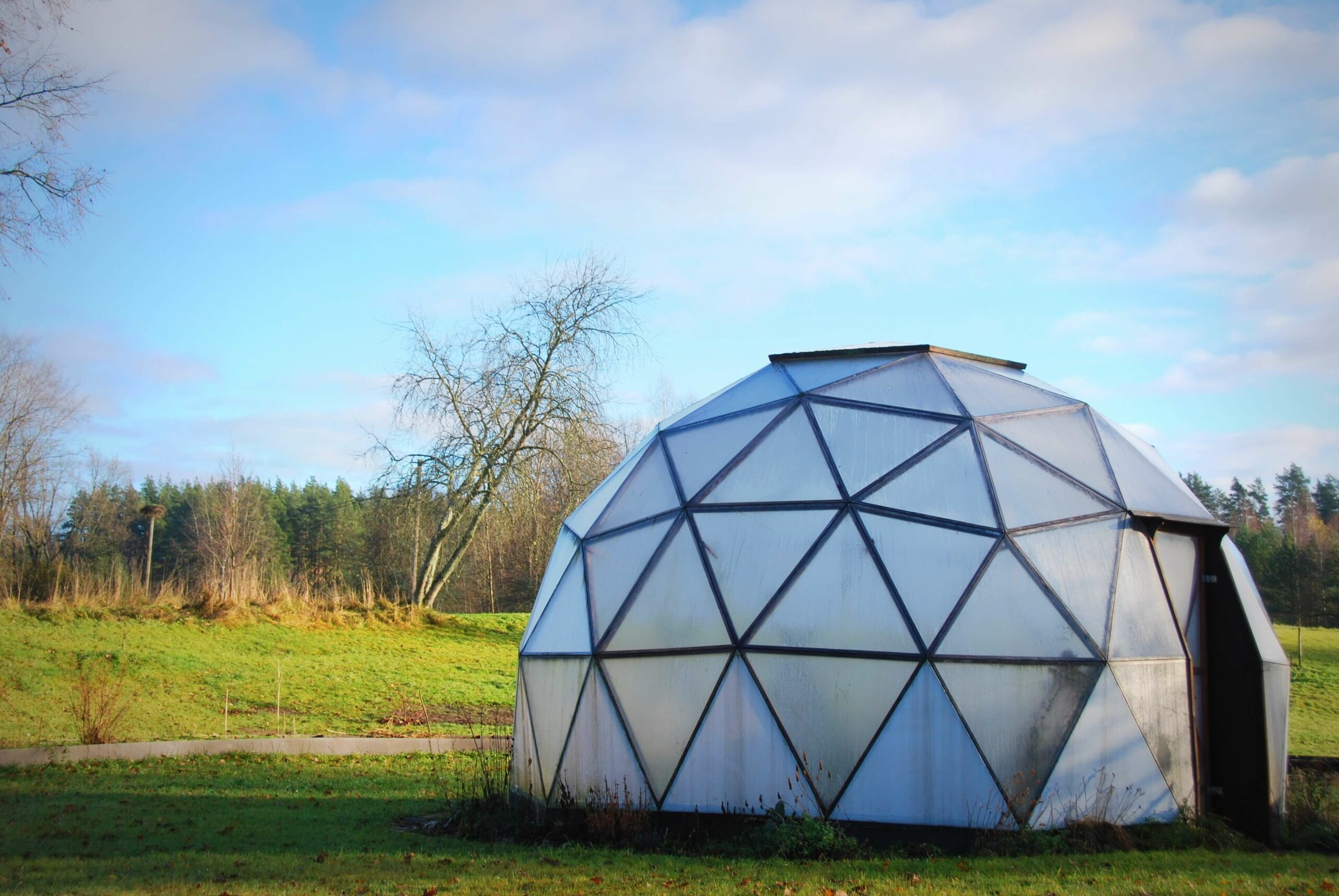 geodesic greenhouse in field